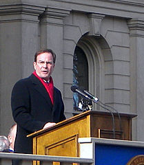 Michigan Attorney General Bill Schuette carries the tea party water jug