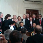 800px-Obama_signing_health_care-20100323