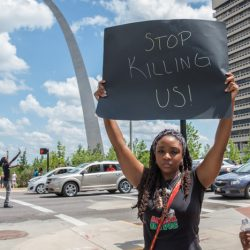 PHOTOS: Netroots Nation attendees join #BlackLivesMatter activists in shutting down a highway in honor of Michael Brown